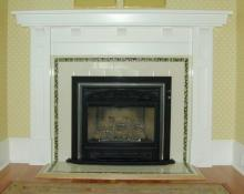 Plain cream tiles laid like brick, with a border of moulded tiles in a remodeled 1910 house