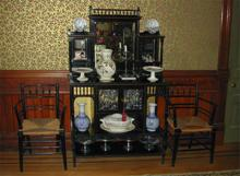 "An English ebonized Aesthetic Sideboard of the 1880's, flanked by two original William Morris ""Sussex"" chairs with rush seats. Morris made these chairs from c1865 until the 1920's."